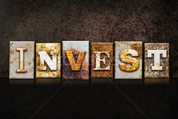 Stock photo: Invest Letterpress Concept on Dark Background