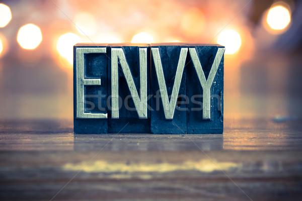 Invidiare metal tipo parola scritto Foto d'archivio © enterlinedesign