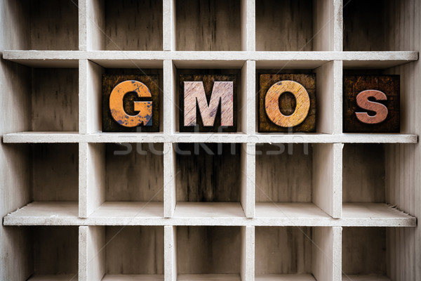 GMOs Concept Wooden Letterpress Type in Draw Stock photo © enterlinedesign