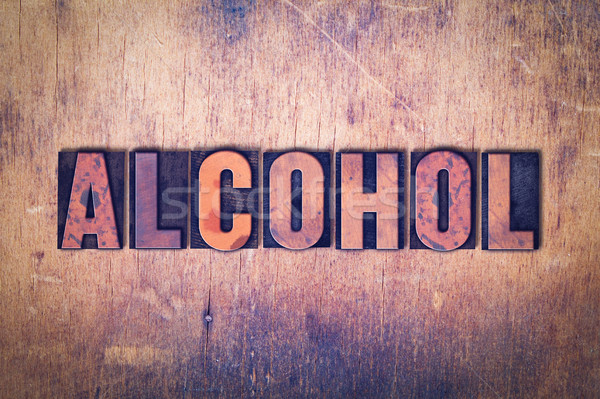 Alcohol Theme Letterpress Word on Wood Background Stock photo © enterlinedesign