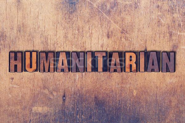 Stock photo: Humanitarian Theme Letterpress Word on Wood Background