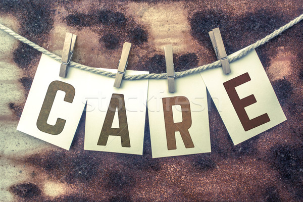 Care Concept Pinned Stamped Cards on Twine Theme Stock photo © enterlinedesign