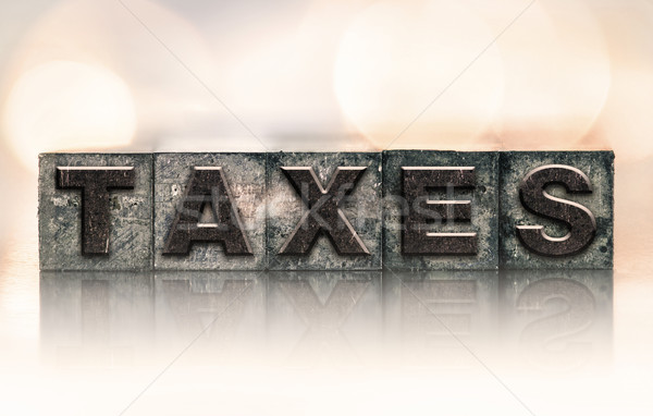 Taxes Concept Vintage Letterpress Type Stock photo © enterlinedesign