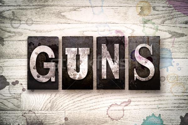 Guns Concept Metal Letterpress Type Stock photo © enterlinedesign