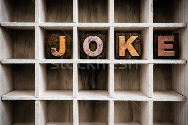 Joke Concept Wooden Letterpress Type in Draw Stock photo © enterlinedesign