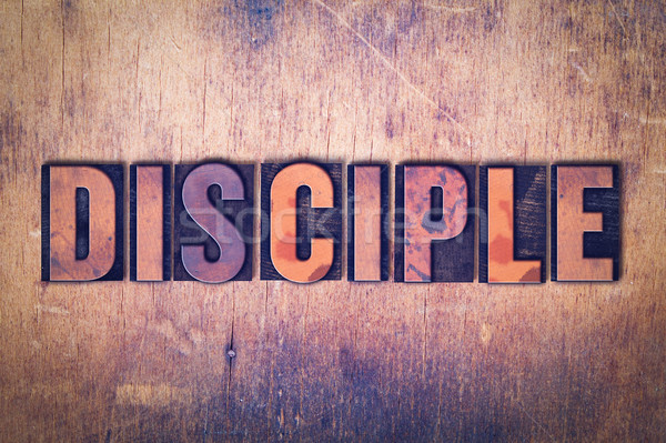 Disciple Theme Letterpress Word on Wood Background Stock photo © enterlinedesign