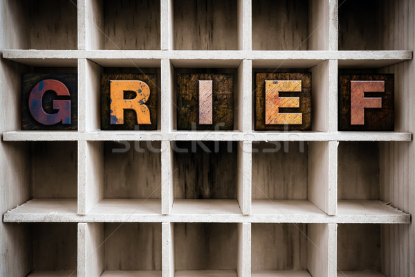 Grief Concept Wooden Letterpress Type in Draw Stock photo © enterlinedesign