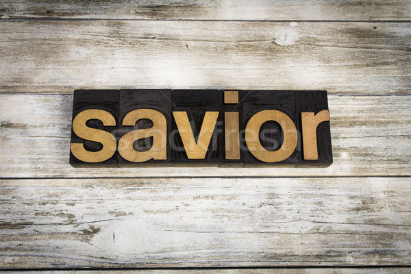 Savior Letterpress Word on Wooden Background Stock photo © enterlinedesign