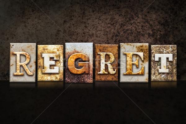 Regret Letterpress Concept on Dark Background Stock photo © enterlinedesign