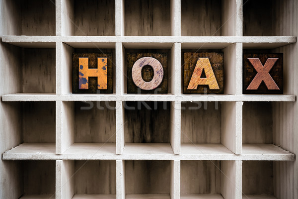 Hoax Concept Wooden Letterpress Type in Draw Stock photo © enterlinedesign