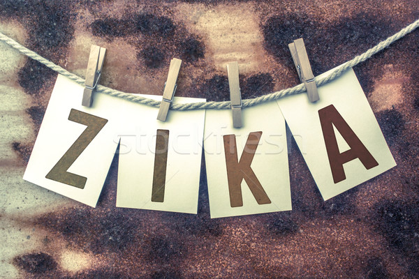 Zika Concept Pinned Stamped Cards on Twine Theme Stock photo © enterlinedesign