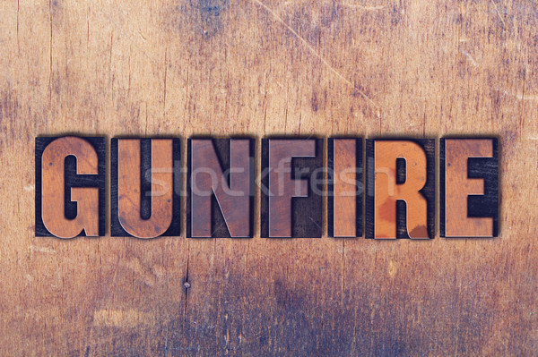 Gunfire Theme Letterpress Word on Wood Background Stock photo © enterlinedesign