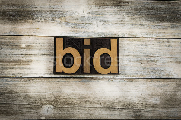 Bid Letterpress Word on Wooden Background Stock photo © enterlinedesign