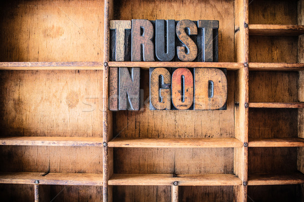 Trust in God Concept Wooden Letterpress Theme Stock photo © enterlinedesign