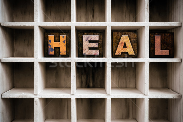 Heal Concept Wooden Letterpress Type in Draw Stock photo © enterlinedesign