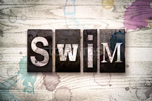 Swim Concept Metal Letterpress Type Stock photo © enterlinedesign