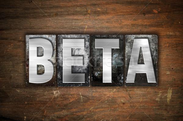 Beta metaal type woord geschreven Stockfoto © enterlinedesign