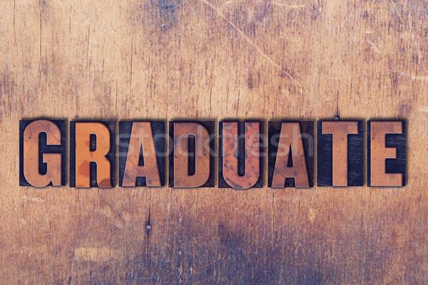 Graduate Theme Letterpress Word on Wood Background Stock photo © enterlinedesign