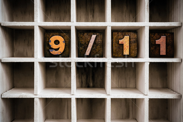 9/11 Concept Wooden Letterpress Type in Draw Stock photo © enterlinedesign