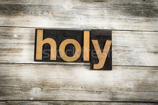 Holy Letterpress Word on Wooden Background Stock photo © enterlinedesign