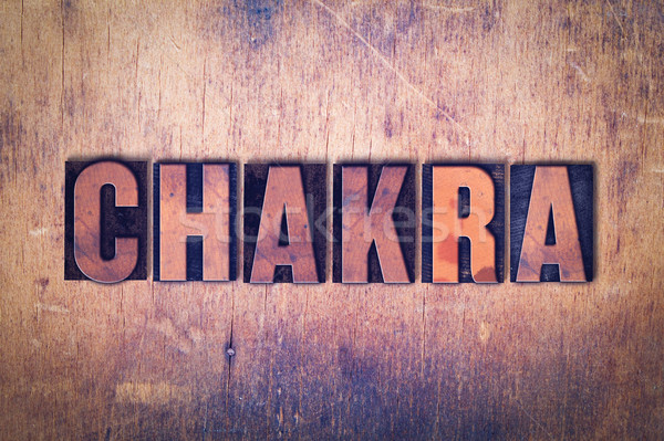 Chakra Theme Letterpress Word on Wood Background Stock photo © enterlinedesign