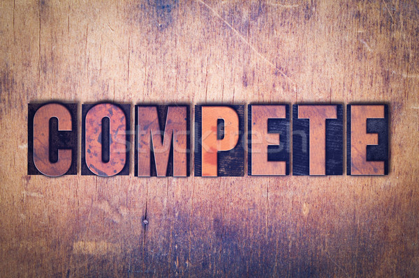 Compete Theme Letterpress Word on Wood Background Stock photo © enterlinedesign