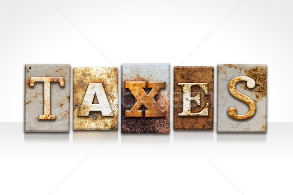 Stock photo: Taxes Letterpress Concept Isolated on White