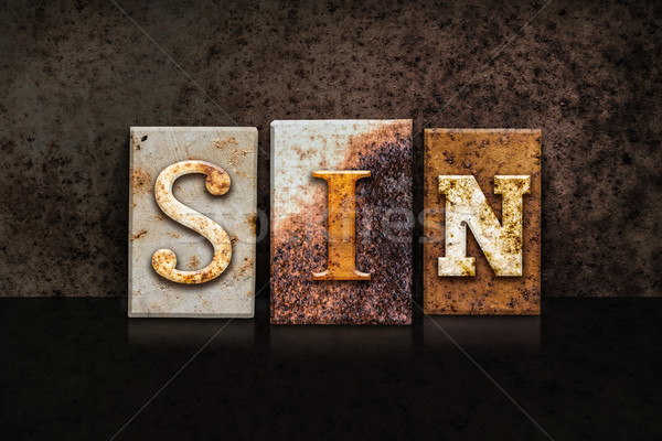 Sin Letterpress Concept on Dark Background Stock photo © enterlinedesign