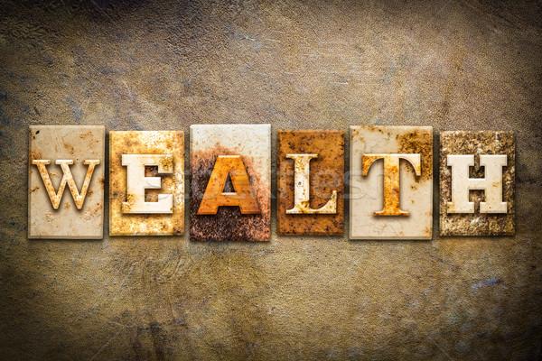 Wealth Concept Letterpress Leather Theme Stock photo © enterlinedesign