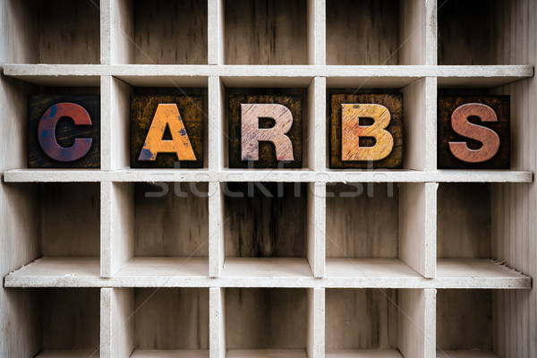 Carbs Concept Wooden Letterpress Type in Draw Stock photo © enterlinedesign
