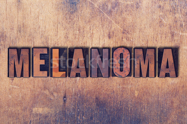 Melanoma Theme Letterpress Word on Wood Background Stock photo © enterlinedesign
