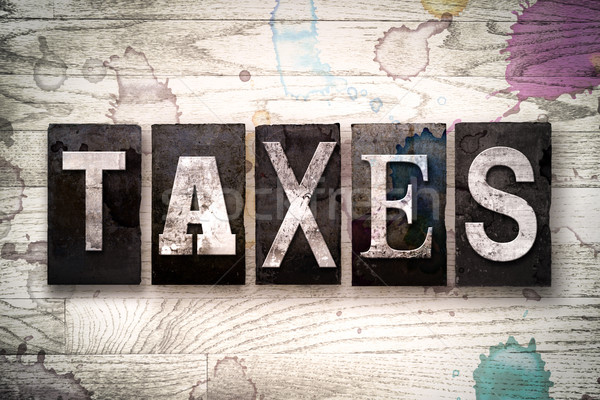 Taxes Concept Metal Letterpress Type Stock photo © enterlinedesign