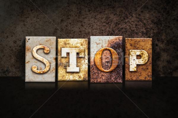 Stop Letterpress Concept on Dark Background Stock photo © enterlinedesign