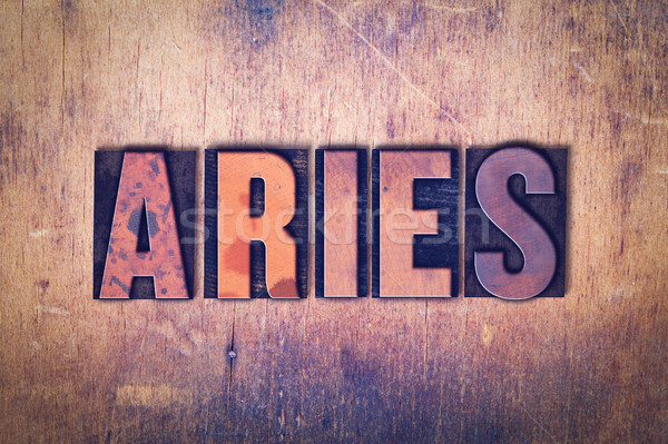 Aries Theme Letterpress Word on Wood Background Stock photo © enterlinedesign