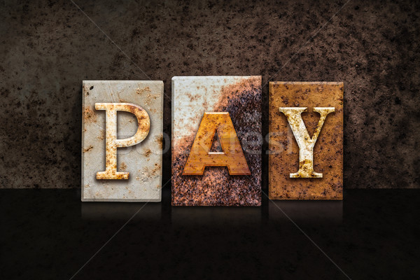 Pay Letterpress Concept on Dark Background Stock photo © enterlinedesign