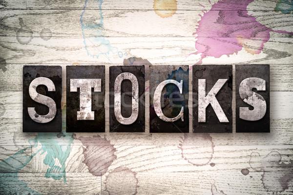 Stocks Concept Metal Letterpress Type Stock photo © enterlinedesign