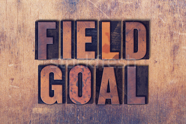 Field Goal Theme Letterpress Word on Wood Background Stock photo © enterlinedesign