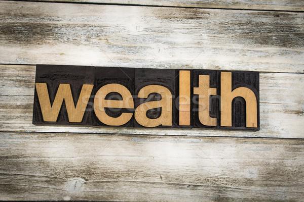 Wealth Letterpress Word on Wooden Background Stock photo © enterlinedesign
