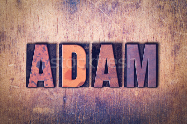 Adam Theme Letterpress Word on Wood Background Stock photo © enterlinedesign