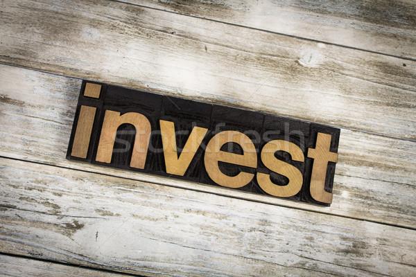 Invest Letterpress Word on Wooden Background Stock photo © enterlinedesign
