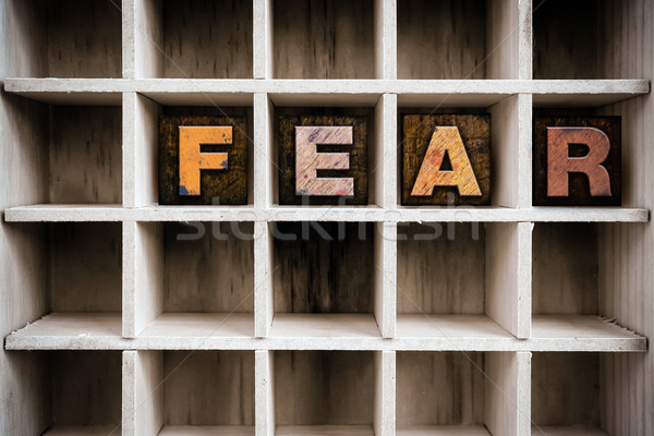 Fear Concept Wooden Letterpress Type in Draw Stock photo © enterlinedesign