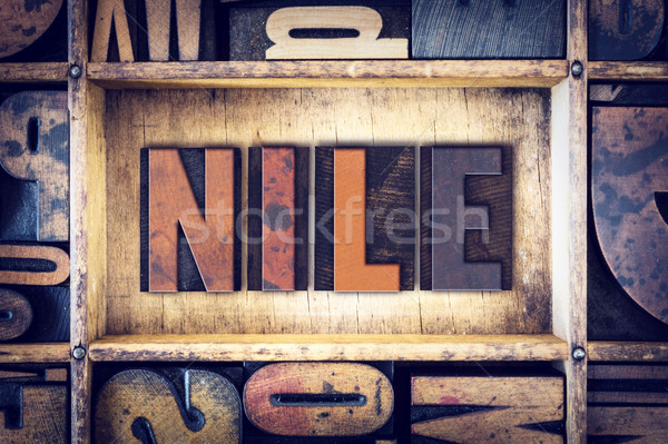 Nile Concept Letterpress Type Stock photo © enterlinedesign
