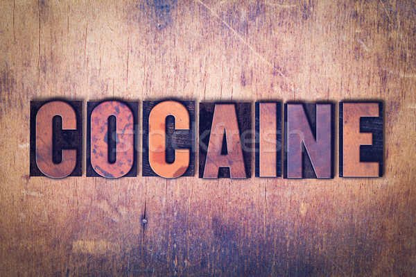 Cocaine Theme Letterpress Word on Wood Background Stock photo © enterlinedesign