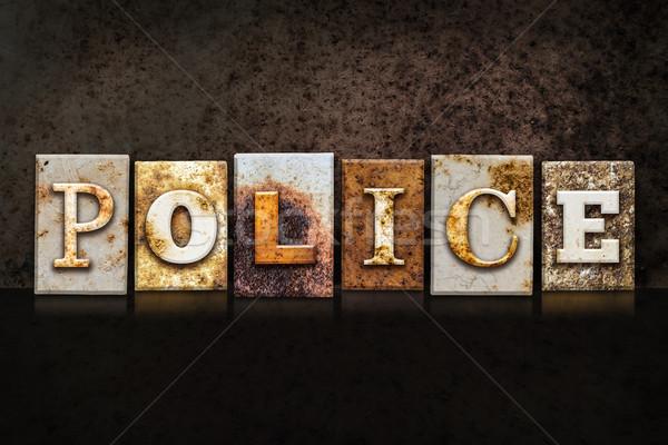 полиции темно слово написанный ржавые Сток-фото © enterlinedesign