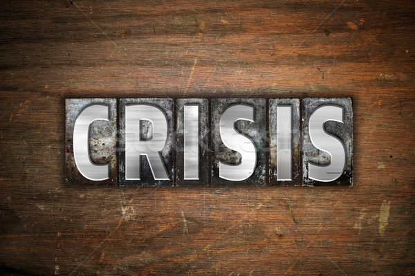 Crisis Concept Metal Letterpress Type Stock photo © enterlinedesign