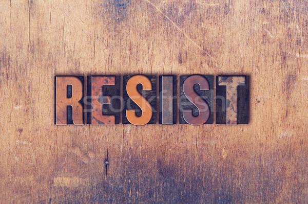 Resist Concept Wooden Letterpress Type Stock photo © enterlinedesign