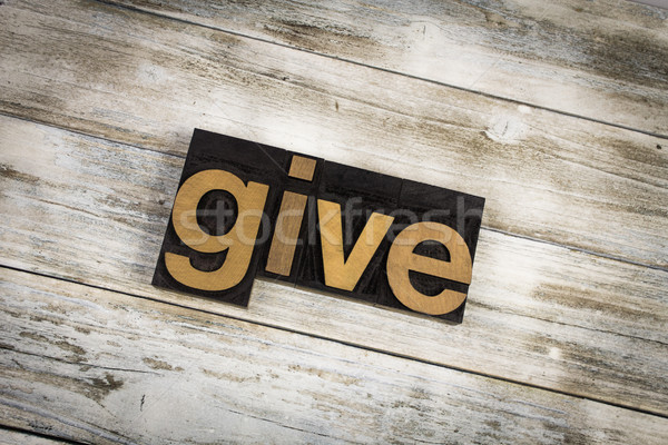 Give Letterpress Word on Wooden Background Stock photo © enterlinedesign