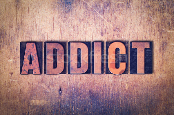 Addict Theme Letterpress Word on Wood Background Stock photo © enterlinedesign