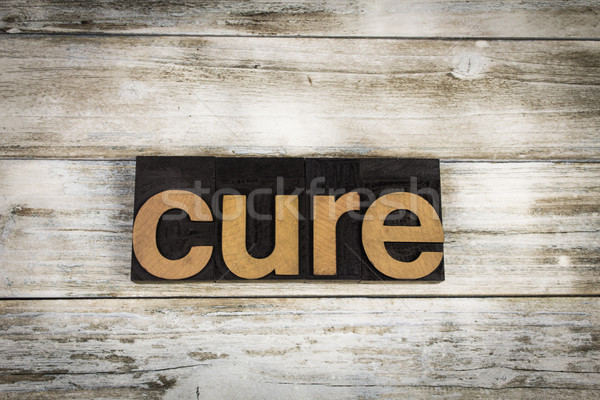 Cure Letterpress Word on Wooden Background Stock photo © enterlinedesign