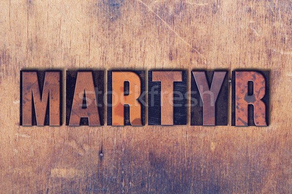 Martyr Theme Letterpress Word on Wood Background Stock photo © enterlinedesign